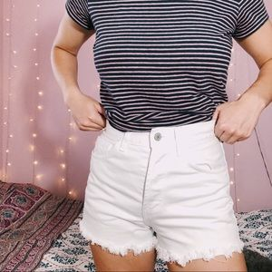 Brandy Melville white cutoff high-waisted shorts